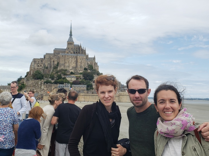 The three of us posing in front of the Mont St Michel and the ocean.