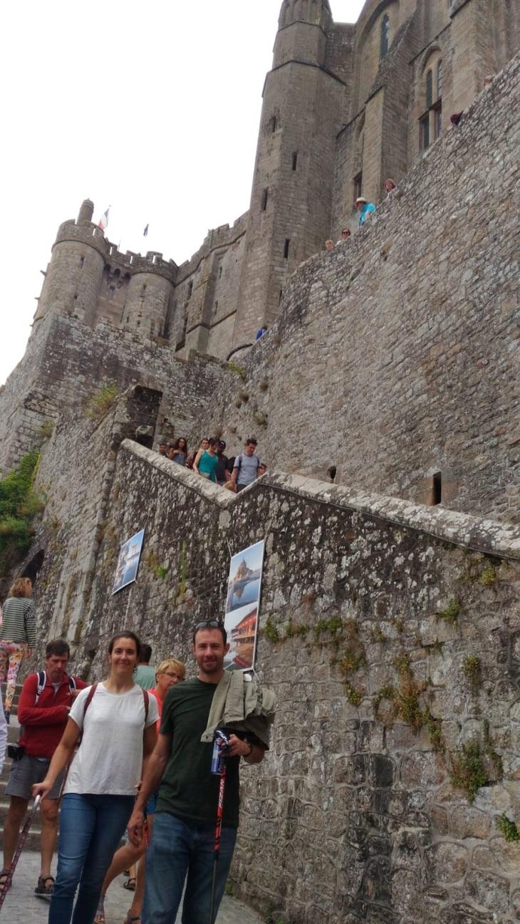 Kerry and Patrick walking along the walls.