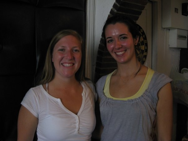 Two ladies pose for a photo.  Kerranna the blond is on the left in a white t-shirt.  Kerry the brunette is on the right wearing a grey t-shirt with a yellow tank underneath.  Tres chic.